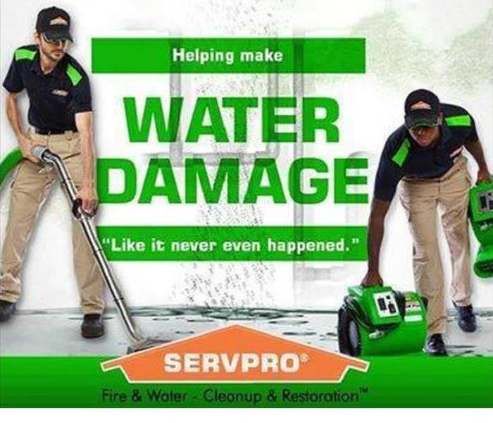 Two SERVPRO Technicians are shown cleaning up water damage
